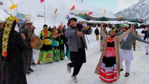 Local people dance during the second Lowari Snow Jeep Rally Competition, in Chitral, Pakistan, 09 January 201