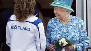 Queen Elizabeth II meets delegates and athletes on a visit to the Athlete's village during day one of the 20th Commonwealth Games on July 24, 2014 in Glasgow