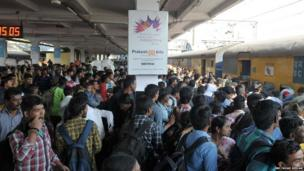 9. Indian passengers wait to board a train bound for coastal districts in the state of Andhra Pradesh at Secunderabad Railway Station in Hyderabad on January 12, 2018. Indian residents are returning to their homes ahead of the Sankranti festival, which will be celebrated on January 13 -16 this year, to mark the begining of the harvest season