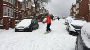 Back in Barry, with no cars on the move, some of the roads were being used for snowboarding