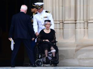Roberta McCain pictured in a wheelchair outside the Washington National Cathedral