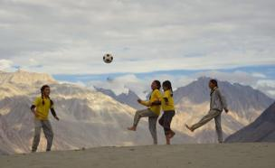 Girls dribble the ball at a height of 10000 ft. in Nubra valley in Ladakh, India's northernmost region