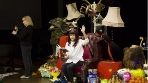 Lindsey Russell performs a reading of one of Roald Dahl's books as part of a National Theatre Wales event