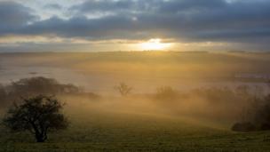 The sun shines through mist over the Menai Strait, taken by Rupert Jones