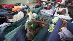 Sick prisoners rest in the infirmary at the National Penitentiary in downtown Port-au-Prince