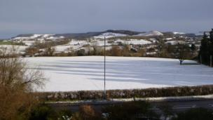 The snow settles in the countryside