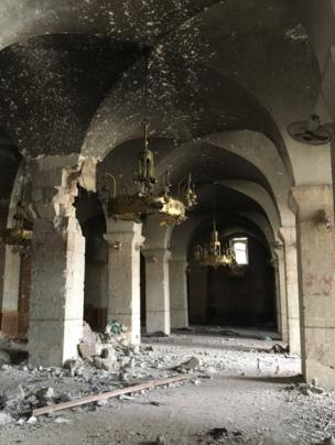 Inside the mosque where candelabras still hang from the ceiling
