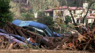 A car is piled up in debris after a mudslide trapped it following heavy rains in Montecito, California.
