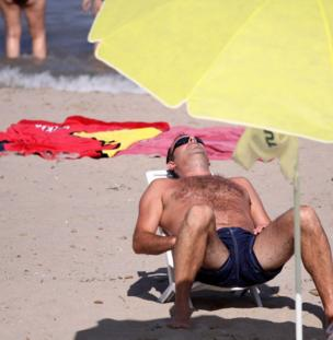 A man sunbathes in the sun