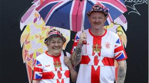 Man and woman dressed in union flag-themed clothing