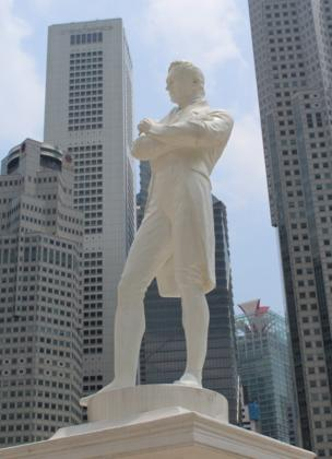 A man with his arms crossed in a city