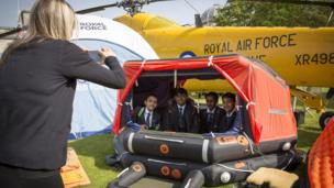 Youngsters at the RAF100 Aircraft Tour in Cardiff try out the rescue dinghy used by the RAF Wessex helicopter which was one of the aircraft on display.