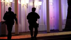armed police officers walking outside casino on Las Vegas Strip