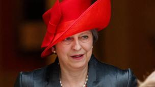 Theresa May leaves Downing Street in a bright red hat ahead of the service at Westminster Abbey