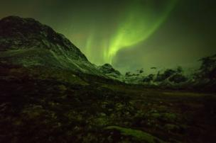 The Northern Lights above the mountains
