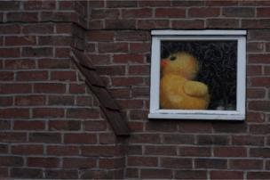 Toy duck in a window