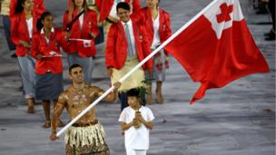 Pita Nikolas Aufatofua of Tonga carries the flag during the Opening Ceremony of the Rio 2016 Olympic Games at Maracana Stadium (August 5, 2016)