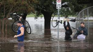 People have been forced to wade through water as it quickly filled the streets.
