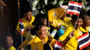Thai spectators watch the Royal Land Procession for King Maha Vajiralongkorn on May 5