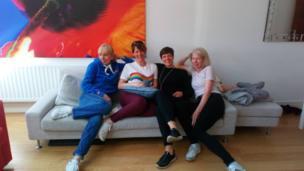 Four women on a sofa