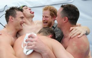 Prince Harry celebrates with UK Armed Forces team captain David Wiseman and the 4x50m relay team at the Invictus Games