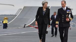 Theresa May talking to captain onboard ship