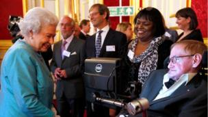"Britain""s Queen Elizabeth (L) meets Stephen Hawking during a reception for Leonard Cheshire Disability charity at St James""s Palace in London May 29, 2014."