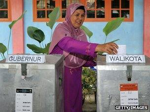 Woman votes at Aceh polling station, 2012