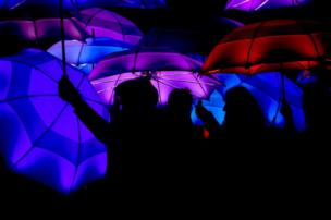 Multicoloured umbrellas at a festival