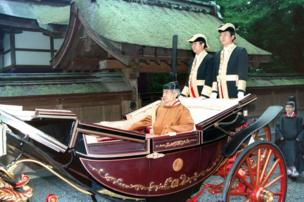 Japan's Emperor Akihito clad in ancient court robes is headed by a carriage for his enthronement at Ise Grand Shrine in Japan, 27 November 1990.