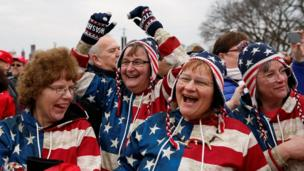 Enthusiastic members of the crowd on the National Mall during President Trump's inauguration