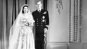 The Queen and Prince Philip pose for an official photograph on their wedding day.