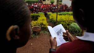 Two pupils read a book in Kenya