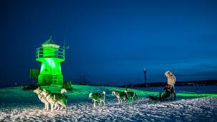 Lighthouse on the frozen Lake Nasijarvi, Finland
