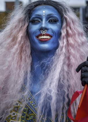 A man with his face painted blue