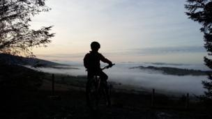 Misty valley view: This shot was taken by Steve Blanchard while mountain biking at Coed Llandegla, Denbighshire.