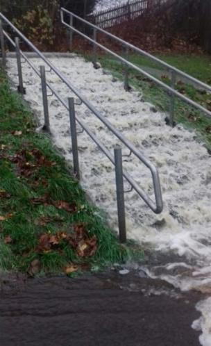 Water gushes down steps in Newcastle