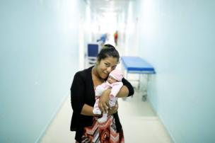 Carmen Jimenez, 33, a Venezuelan from Bolivar state, holds her four-day-old baby Amalia at a maternity hospital in Boa Vista, Roraima state, Brazil, 21 August 2018
