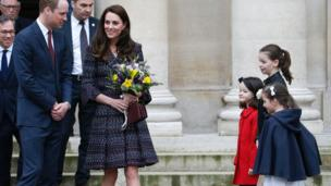 The couple were welcomed by French children