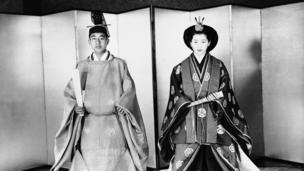 Akihito, left, and his bride Michiko Shoda, who became Princess Michiko pose in the ceremonial robes they wore during wedding ceremony in Shinto temple on the Tokyo Imperial Palace grounds, April 1959