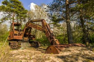 An abandoned digger in a forest