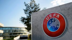 A photo taken on April 6, 2016 shows the logo of European football body UEFA at the UEFA headquarters in Nyon. Swiss police raided the headquarters of European football body UEFA on April 6 following the latest revelations of a web of Panama-based offshore financial dealings by the rich and famous.