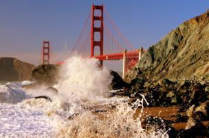 Waves splashing in front of the Golden Gate Bridge