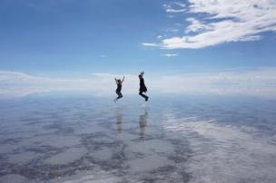 Two people jumping