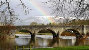 This rainbow over the Wye Bridge at Builth Wells, Powys