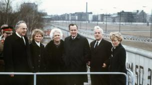 A file picture dated 31 January 1983 shows L-R: A group photo of German Chancellor Helmut Kohl, his his wife Hannelore, Barbara Bush, her husband US Vice President George HW Bush, the Lord Mayor of Berlin Richard von Weizsaecker and his wife Marianne at the Berlin Wall