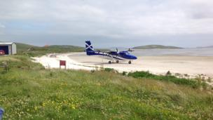 Plane on the beach on Barra