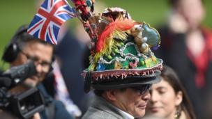 A man with a colourful hat among the crowds in Windsor