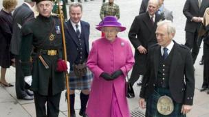 Queen Elizabeth II, centre, arrives at Parliament Square, Edinburgh, Scotland, flanked by First Minister Jack McConnell, fourth from left and George Reid, Presiding Officer, right, Saturday Oct. 9 2004