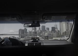 A view of New York City skyline seen through a car window
